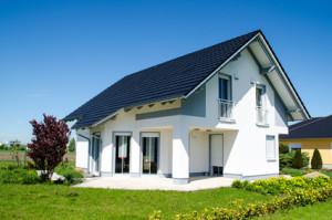 Vorfälligkeitszinsen drohen bei einem Hausverkauf durch die frühzeitige Ablösung des Immobiliendarlehens